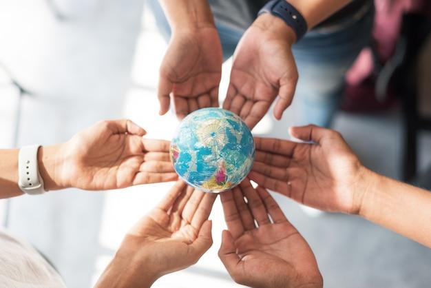 Hands holding small globe Premium Photo