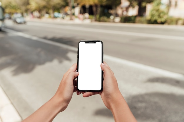 Hands holding smartphone with mock-up Free Photo