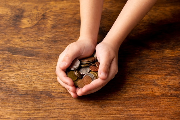 Hands holding a stack of coins Premium Photo