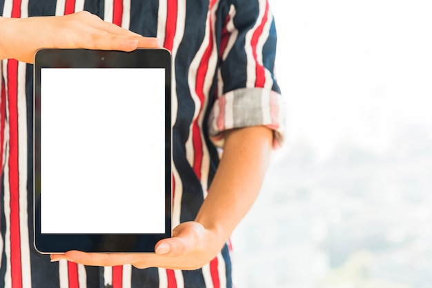 Hands holding tablet with blank screen Free Photo