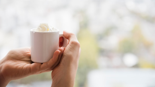 Hands holding teacup Free Photo