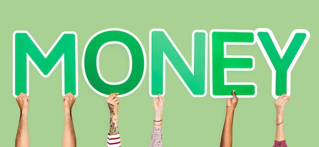 Hands holding up green letters forming the word money Free Photo