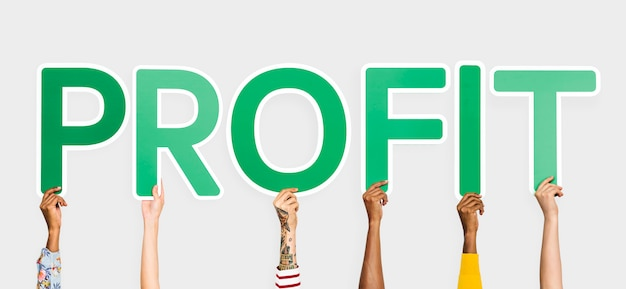 Hands holding up green letters forming the word profit Free Photo