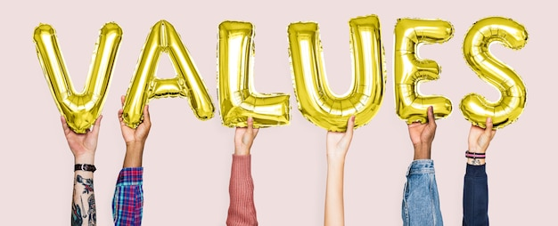 Hands holding values word in balloon letters Premium Photo