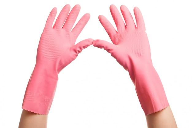 ピンクの家庭用手袋で手を開く 無料写真