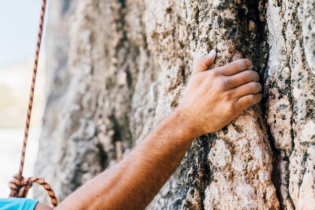 Hands of man climbing Free Photo