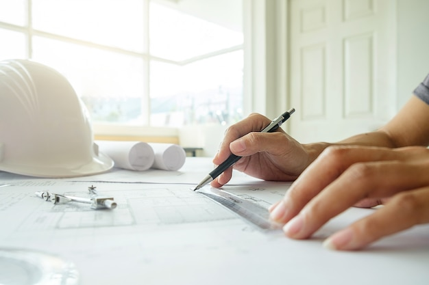 Hands of engineer working on blueprintconstruction concept hands of engineer working on blueprintconstruction concept engineering toolsntage tone retro malvernweather Image collections