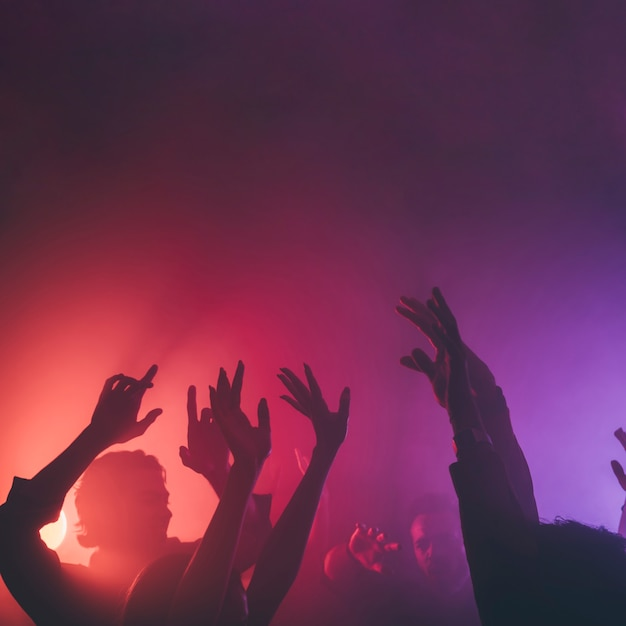 Hands of people in disco Premium Photo