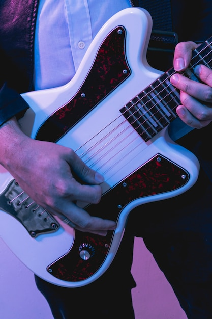 Hands playing beautiful electric guitar Free Photo