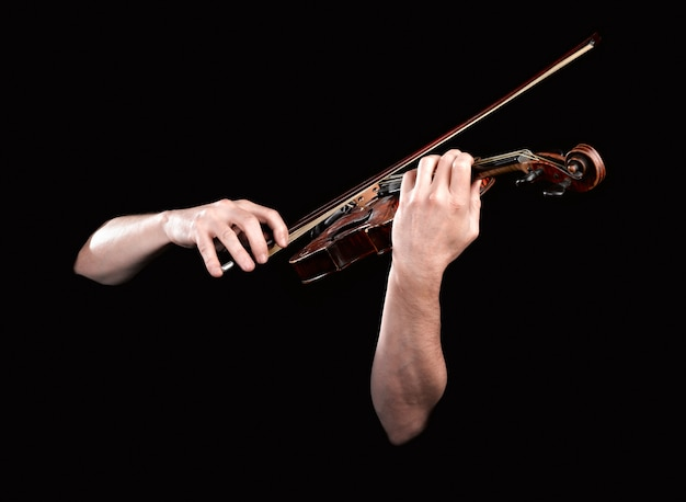 Hands playing  wooden violin Premium Photo