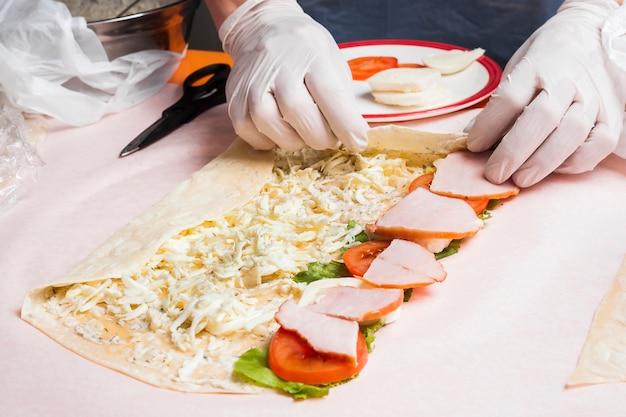 Hands preparing burrito Free Photo