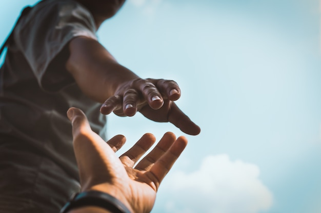 Hands reaching out to help. Premium Photo
