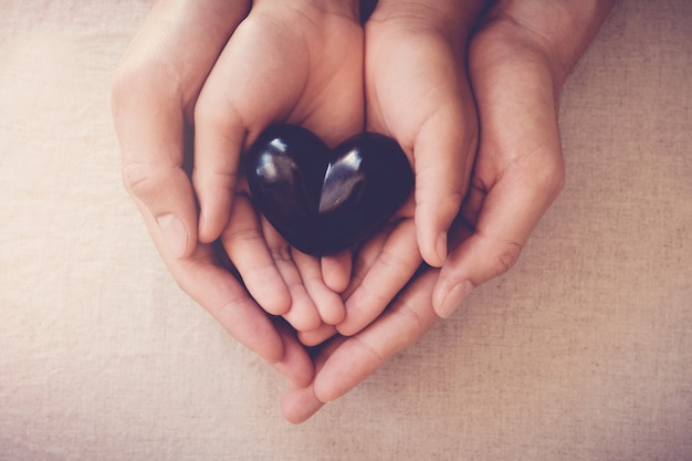 Hands and red heart, health insurance Premium Photo