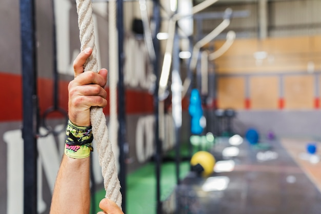Hands on rope in gym Free Photo