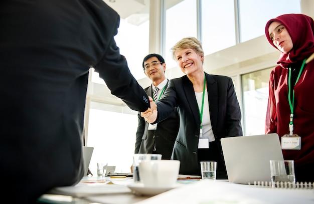 Hands shake agreement diversity conference partnership Premium Photo
