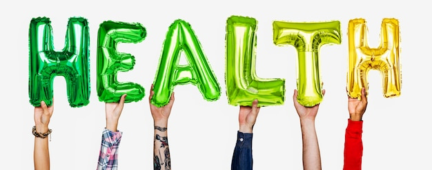 Hands showing health balloons word Free Photo
