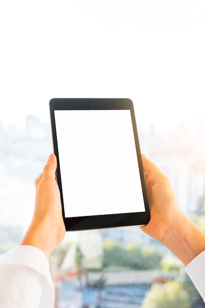 Hands showing a tablet with blank screen Free Photo