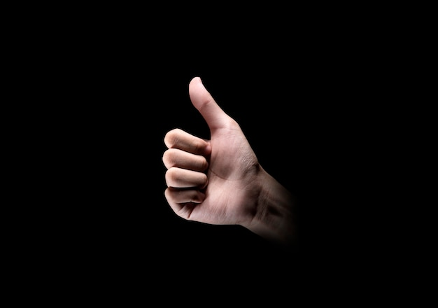 Hands showing thumb up gesture Premium Photo
