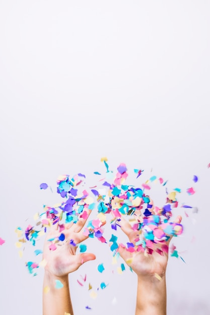Hands throwing confetti Free Photo