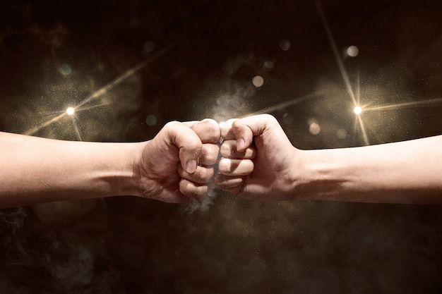 Hands of two men bumped their fists Premium Photo