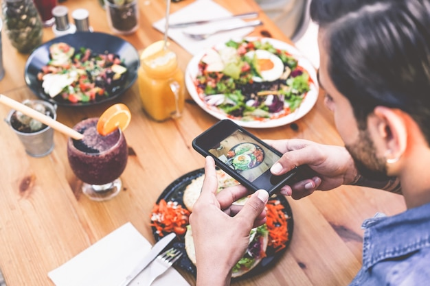 Hands View Of Influencer Man Eating Brunch While Making Video Of