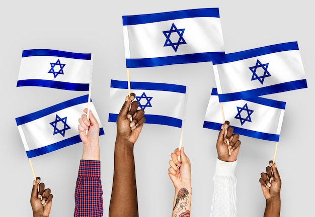 Hands waving flags of israel Free Photo