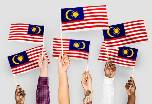 Hands waving flags of malaysia Free Photo