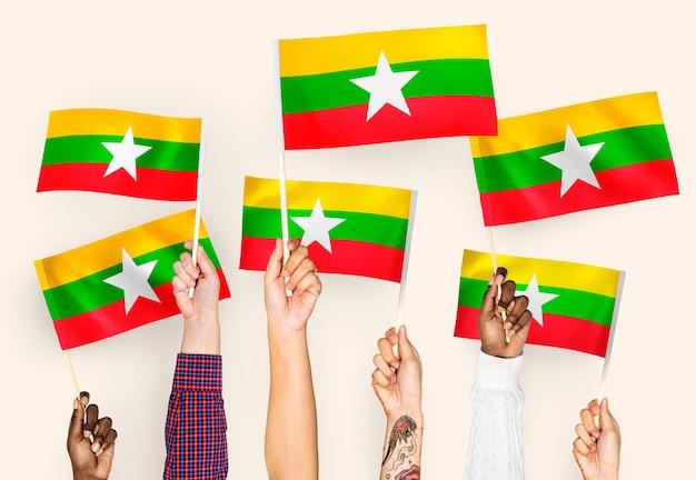 Hands waving flags of myanmar Free Photo
