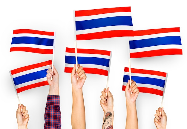 Hands waving flags of thailand Free Photo