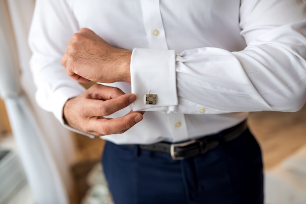 Hands of wedding groom getting ready in suit. man getting ready for work. Premium Photo