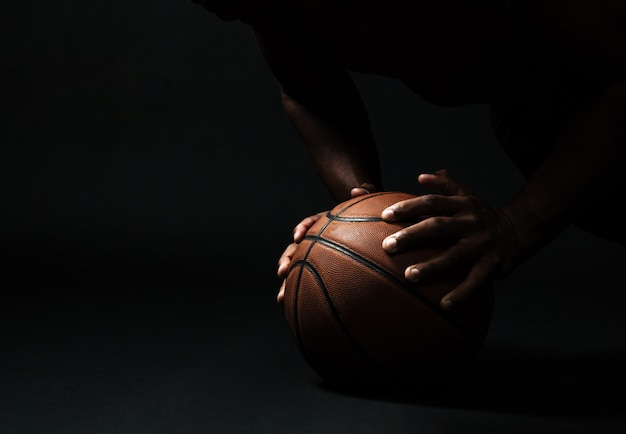 Hands with basketball ball Free Photo