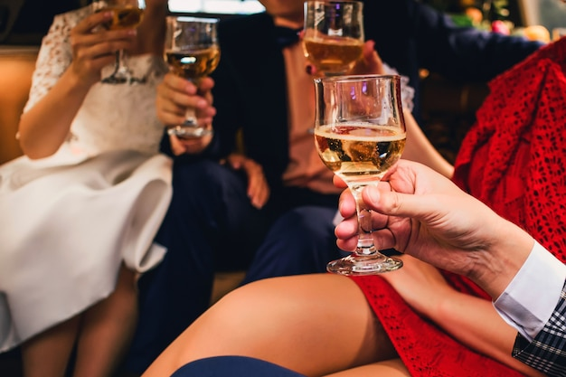 Hands with champagne glasses celebrating wedding Premium Photo