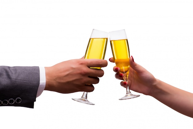 Hands with glasses of champagne isolated on white Premium Photo