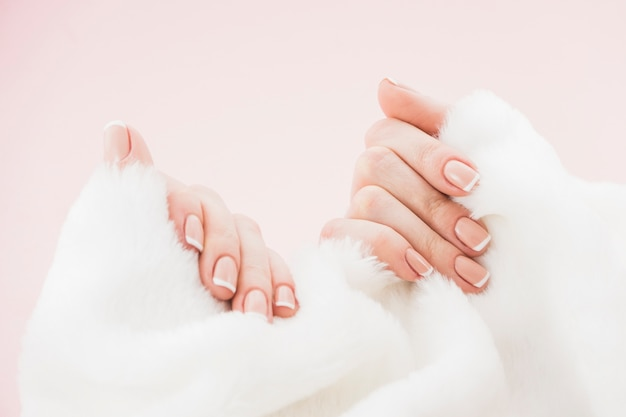 Hands with manicure holding towel Free Photo