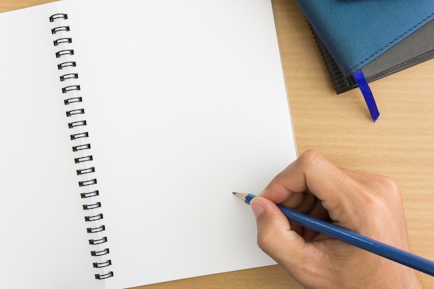 Hands with pencil over notebook Premium Photo