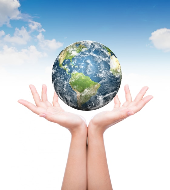Hands with planet earth above Free Photo