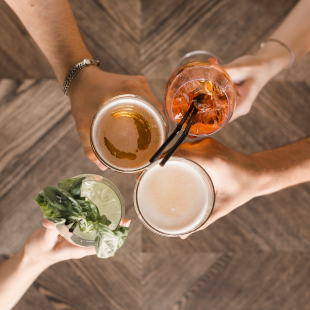 Hands with vivid drinks toasting Free Photo