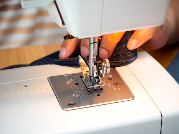 Hands working on the sewing machine Premium Photo
