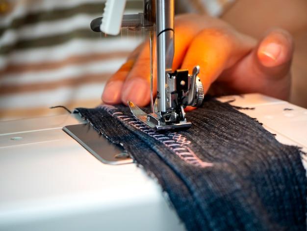 Hands working on the sewing machine Premium Photo