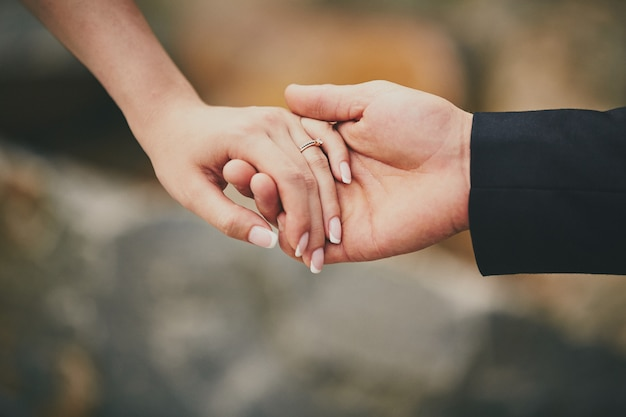 Hands of a young couple with a ring Premium Photo