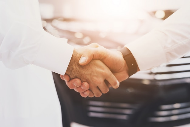 Handshake deal hands of arab customer and dealer. Premium Photo