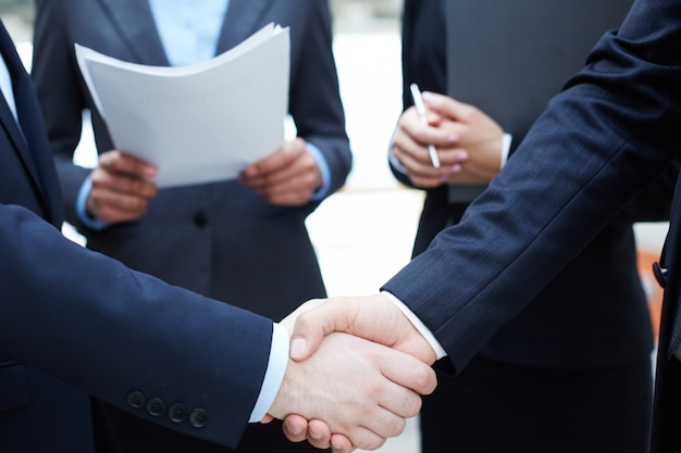 Handshake of executives greeting each other Free Photo