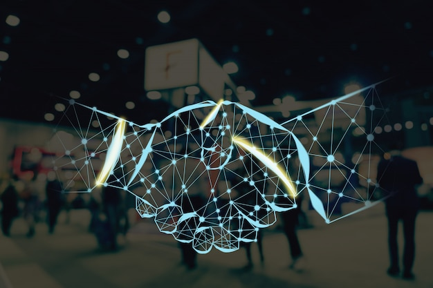 Handshake shape writing by lines and dots over abstract blurred photo of financial exhibition event Premium Photo