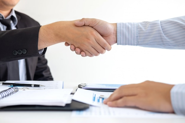 Handshake of two business people after contract agreement to become partner Premium Photo