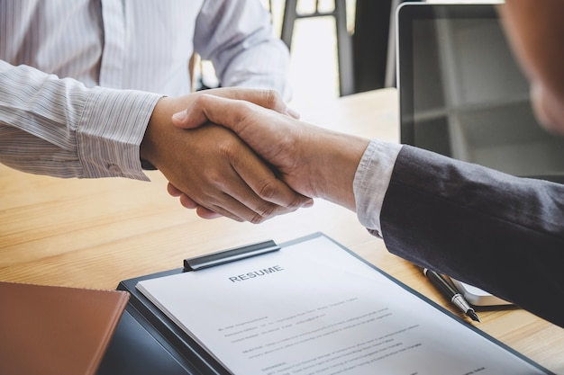 Handshake while job interviewing, candidate shaking hands with interviewer after a job interview Premium Photo