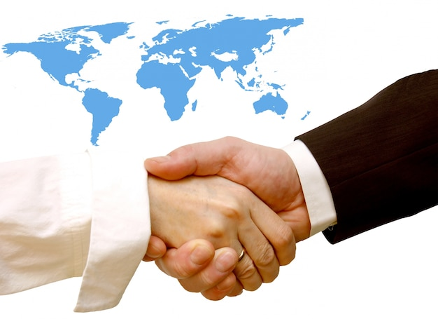 Handshake with a world map background photo free download handshake with a world map background free photo gumiabroncs Images
