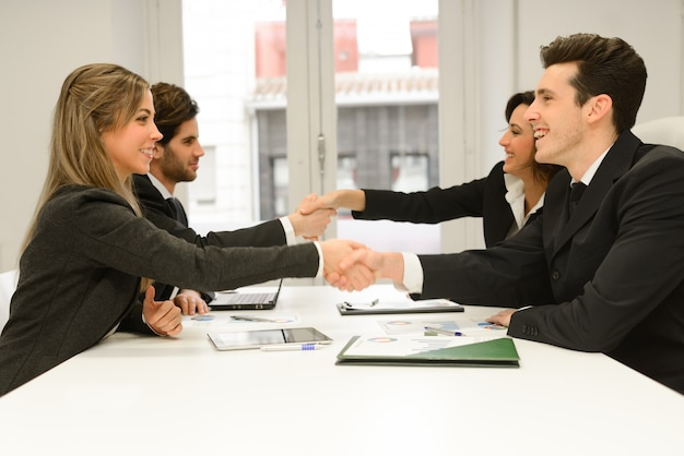 Handshakes in a meeting at the office Free Photo