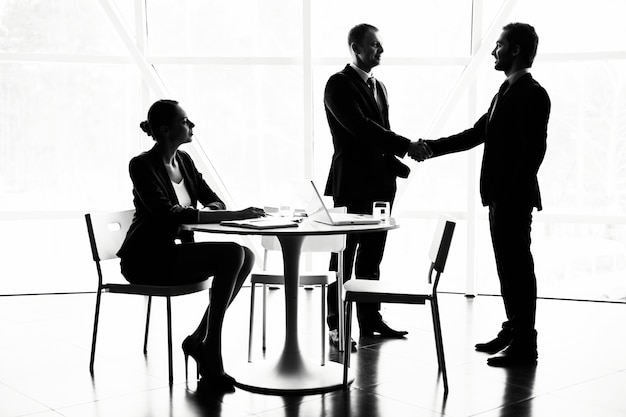 Handshaking after interview Free Photo