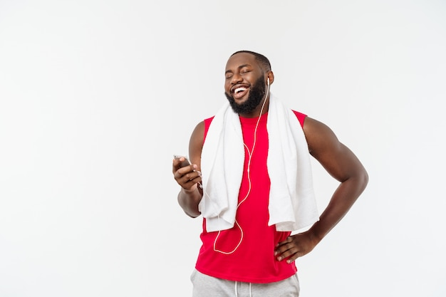 Handsome african american man listening music on his mobile device after sport exercise. Premium Photo