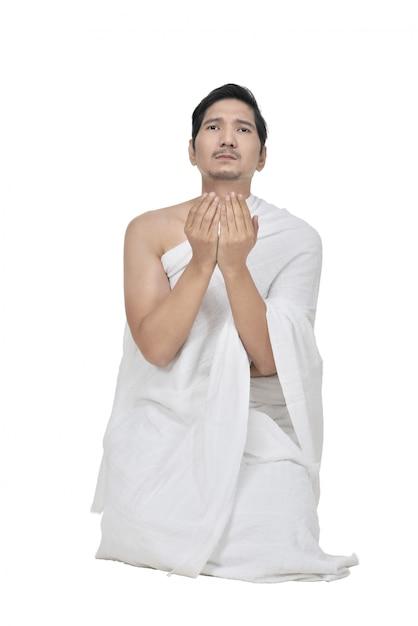 Handsome asian hajj pilgrim praying to god Premium Photo